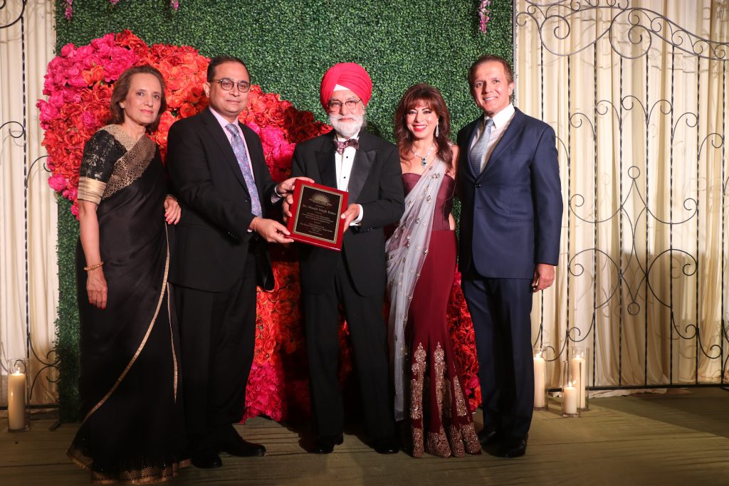 Dr. Bains receives plaque from Khubanis and Counsel General