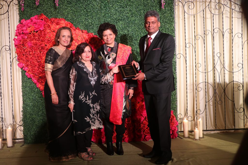 Ravi receives plaque from Lavina, Dina and Chandrika