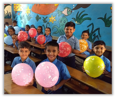 Smiling Kids with Balloons